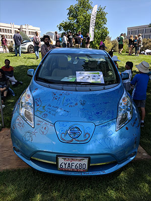 "Image of ""Whiteboard"" Nissan Leaf Decorated With Drawings at EV Showcase 2018"