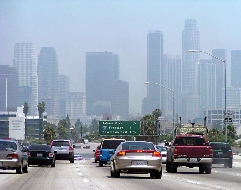 Image of cars driving on Los Angeles freeway with smog in the distance